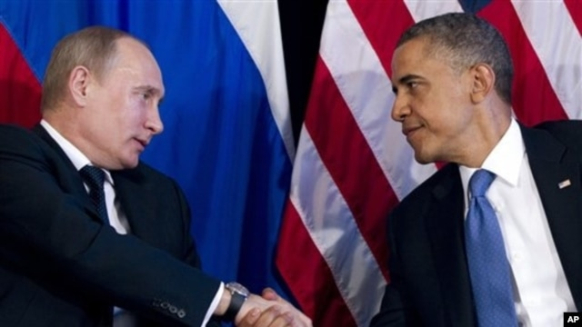 President Barack Obama shakes hands with Russian President Vladimir Putin, G20 Summit, Los Cabos, Mexico, June 18, 2012.
