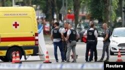 Policías aseguran la escena del atentado en Lieja, Bélgica el 29 de mayo de 2018.