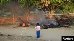 Unidentified man photographs bodies burning in the wake of sectarian riots in Meikhtila, Burma, March 22, 2013.