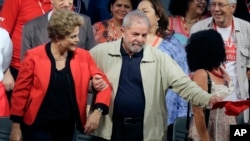 FILE - In this Oct.13, 2015 file photo, Brazil's former President Luiz Inacio Lula da Silva, right, and current President Dilma Rousseff, attend the Central Workers Union annual convention in Sao Paulo, Brazil. The Brazilian government's leader in the lower house of Congress said Wednesday, March 16, 2016, that Silva has been named chief of staff to Rousseff. It's a move that could help Silva avoid possible detention in expanding corruption probes that have now touched the top of Brazil's political leadership. (AP Photo/Nelson Antoine, File)