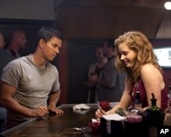 Left to right: Mark Wahlberg plays Micky Ward and Amy Adams plays Charlene Fleming in THE FIGHTER.