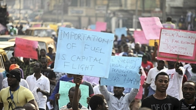 Protesters hold placards, shout slogans on Ikorodu road in Nigeria's commercial capital, Lagos, January 3, 2012.