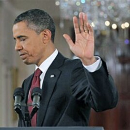 President Barack Obama waves as he turns to leave after a news conference in the East Room of the White House, 03 Nov 2010