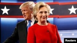 Republican U.S. presidential nominee Donald Trump and Democratic U.S. presidential nominee Hillary Clinton take the stage for their first debate in Hempstead, New York, Sept. 26, 2016.