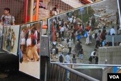 北區水貨客關注組在收集市民簽名的街站,展出水貨客滋擾的照片