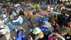 FILE - Chadian refugees are seen inside a refugee camp at the border town of Kousseri, Cameroon. Suicide bombers attacked a fish market on Oct. 10, 2015 in the Chadian town of Baga Sola and the Kousseri site for internally displaced people.