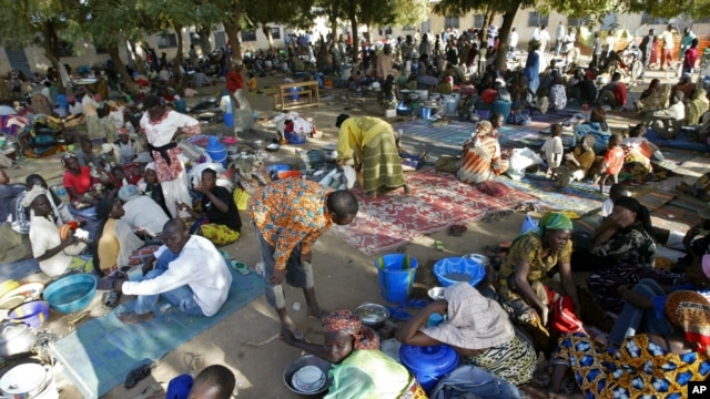 FILE - Chadian refugees are seen inside a refugee camp at the border town of Kousseri, Cameroon, Feb. 7, 2008.