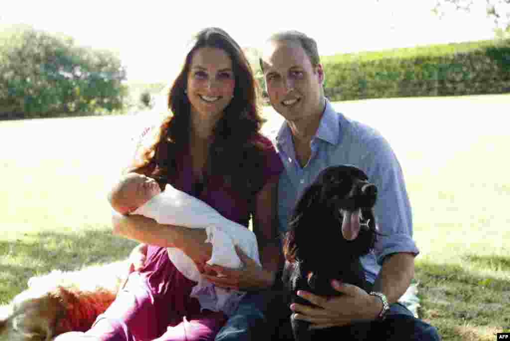 A handout picture released on August 19, 2013 by Kensington Palace shows Prince William, Duke of Cambridge, his wife Catherine, Duchess of Cambridge, with their newborn baby boy, Prince George of Cambridge, Tilly the retriever (L), a Middleton family pet