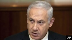 Israel's Prime Minister Benjamin Netanyahu, pictured here at a weekly meeting of his cabinet April 3, 2011, has issued a written statement calling on the UN to retract its Gaza war crimes report
