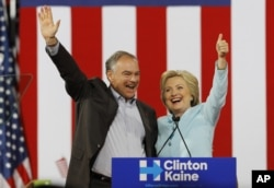 Democratic U.S. vice presidential candidate Senator Tim Kaine of Virginia waves with his presidential running mate Hillary Clinton at a campaign rally in Miami, Florida, U.S. July 23, 2016.