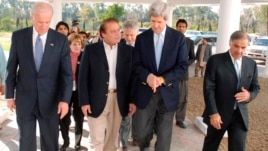Prime minister Nawaz Sharif, second from left, walks along with then-U.S. Senators John Kerry, Joseph Biden, Chuck Hegel and his party president Shahbaz Sharif, Lahore, Feb 18, 2008 file photo.