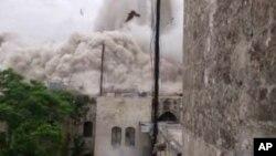 Ảnh chụp từ video của nhóm tự xưng là Mặt Trận Hồi giáo Aleppo cho thấy hiện trường nơi xảy ra vụ nổ, ngày 8/5/2014.