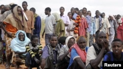 FILE - Somali refugees line up to wait for the reception center to open at Ifo settlement at Kenya's Dadaab Refugee Camp, situated northeast of the capital Nairobi near the Somali border, September 1, 2011.
