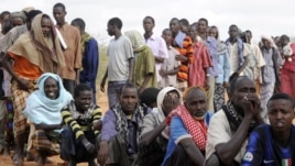 Newly arrived Somali refugees line up to wait for the reception center to open at Ifo settlement at Kenya's Dadaab Refugee Camp, situated northeast of the capital Nairobi near the Somali border, September 1, 2011.