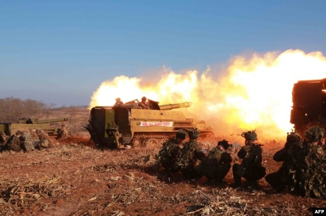 FILE - A firing contest of Korean People's Army artillery units, which North Korean leader Kim Jong Un inspected, at an undisclosed location in North Korea, Jan. 15, 2015.
