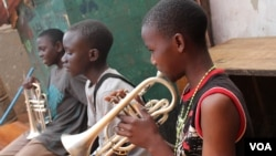 The children living at M-lisada practice their instruments every day, Kampala, Uganda, Oct. 11, 2013. (VOA/Hilary Heuler)