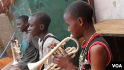 Children play their instruments every day in Kampala, Uganda.