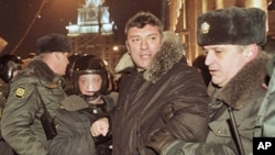 Riot police officers detain Russian opposition leader Boris Nemtsov during a rally in central Moscow, 31 Dec 2010
