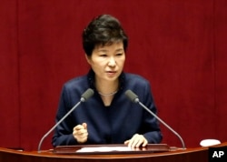FILE - South Korean President Park Geun-hye delivers a speech at the National Assembly in Seoul.