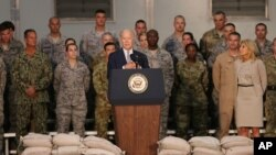 U.S. Vice President Joe Biden talks to U.S. military personnel at Al-Dhafra Air Base near Abu Dhabi, United Arab Emirates, Monday, March 7, 2016.