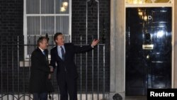 2016年1月31日英国首相卡梅伦(右)和欧洲理事会主席图斯克在伦敦唐宁街