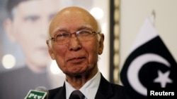 FILE - Pakistani national security adviser Sartaj Aziz, pictured at a news conference in April, says his country is sharing information with Afghanistan to try to prevent the Taliban from using Pakistan's side of the porous frontier.