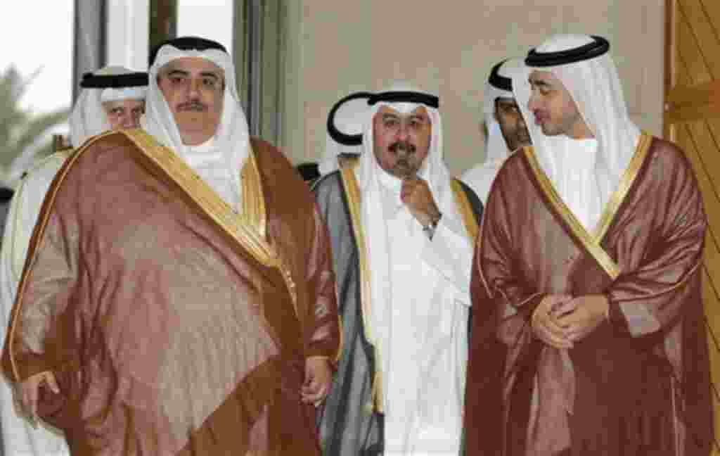 Bahrain's Foreign Minister Sheikh Khaled bin Ahmad al-Khalifa, left, Kuwait's Foreign Minister Sheik Mohammed Al Sabah, center, and United Arab Emirates Foreign Minister, Sheik Abdullah bin Zayed Al Nahyan, right, arrive to their meeting with the Yemeni o
