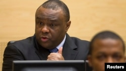 Jean-Pierre Bemba, a former vice president of the Democratic Republic of Congo, speaks at the opening of his trial in The Hague, Nov. 22, 2010.