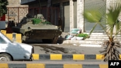 A tank is positioned next to home of Yemeni President Abdrabuh Mansur Hadi in the capital, Sana'a, as international concern grows over attacks by Shi'ite militia on the presidency, Jan. 21, 2015.