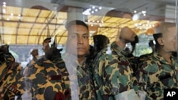 Members of Bangladesh Rifles (BDR) who are accused of a mutiny wait to be brought back to jail after a hearing before a special court in Dhaka on July 12, 2010