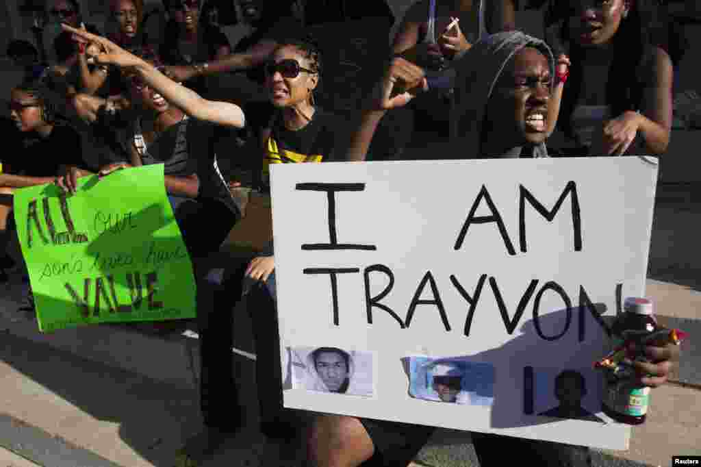 Protesters rally in New York's Brooklyn borough, in response to the acquittal of George Zimmerman in the shooting death of Trayvon Martin trial, July 14, 2013. Zimmerman, cleared by a Florida jury of six women, still faces public outrage, a possible civil suit and demands for a federal investigation.