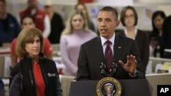 President Barack Obama, accompanied by American Red Cross President and CEO Gail J. McGovern, gestures while speaking during his visit to discuss superstorm Sandy, at the Disaster Operation Center of the Red Cross National Headquarters in Washington, Oct.