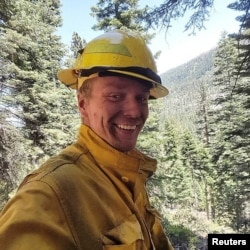 FILE - Firefighter Michael Hallenbeck, in a handout photo provided by the United States Department of Agriculture Forest Service (USDA), died Saturday of injuries received while battling a wildfire at the Lake Tahoe Basin fire in California.