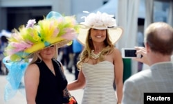 The Kentucky Derby is a BIG deal in Kentucky. People usually dress up to wathch the famous horse race. Women wear big, beautiful hats. May 3, 2014 (Jamie Rhodes-USA TODAY Sports)