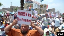 A supporter of Egypt's ousted president Mohamed Morsi at a Muslim Brotherhood rally iin Cairo, July 12, 2013. (Nagwa el-Hamzawi for VOA)