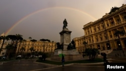 FILE - A rainbow is seen over Italy's Court of Cassation palace in Rome, March 27, 2015.