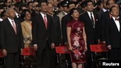 Former Hong Kong Chief Executives Tung Chee-hwa (front L), Donald Tsang (front R), new Hong Kong Chief Executive Leung Chun-ying (front 2nd L), his wife during a ceremony in Hong Kong, July 1, 2012.