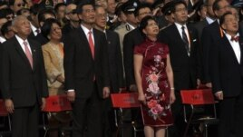Former Hong Kong Chief Executives Tung Chee-hwa (front L), Donald Tsang (front R), new Hong Kong Chief Executive Leung Chun-ying (front 2nd L), his wife during a ceremony in Hong Kong, July 1, 2012.