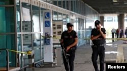 FILE - Police officers patrol at Turkey's largest airport, Istanbul Ataturk, June 29, 2016. Two men were detained after a police pursuit at the airport Saturday.
