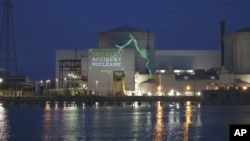 """This Greenpeace photo shows a video projection reading """"Tricastin, nuclear accident, """" on the Tricastin power plant complex, July 15, 2013 in southern France."""