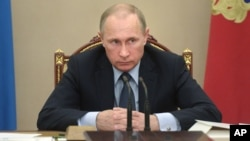 FILE - Russian President Vladimir Putin listens during meeting at the Kremlin, Moscow, May 27, 2015.