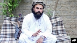 The deputy commander of the Pakistani Taliban Waliur Rehman speaks to The Associated Press in Shaktoi, Pakistani, May 16, 2011