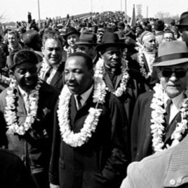 Martin Luther King Jr. leads a march to Alabama's capital, Montgomery, to protest unfair voting laws