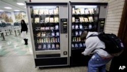 A student buys snacks from one of the vending machines at Lane Tech High School Thursday, Dec. 15, 2005, in Chicago. While the Chicago Public Schools have had a ban on junk food in place for some time, Illinois Gov. Rod Blagojevich now wants a statewide
