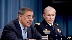 Defense Secretary Leon E. Panetta and Army Gen. Martin E. Dempsey, chairman of the Joint Chiefs of Staff brief the media in the Pentagon Briefing Room on major budget decisions stemming from the defense strategic guidance, January 26, 2012.