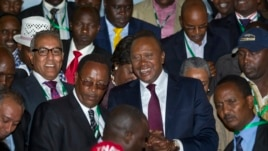 Kenya's President-Elect Uhuru Kenyatta arrives at the the National Election Center where final election results were announced declaring he would be the country's next president, in Nairobi,March 9, 2013.