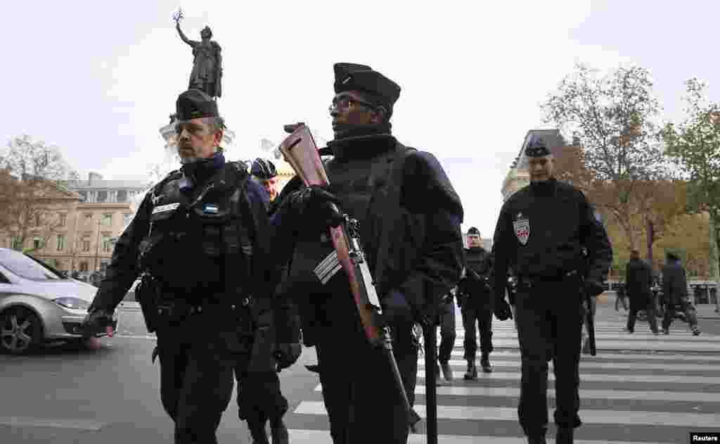 Police patrol in Place de la Republique Saturday after a series of deadly attacks the previous day in Paris, Nov. 15, 2015.