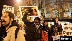Demonstrators march through the streets following the grand jury decision in the Ferguson, Missouri shooting of Michael Brown, in Seattle, Washington November 24, 2014. The case has highlighted long-standing racial tensions not just in predominantly black