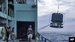 Scientists prepare to sample the ocean on the RV Knorr in August 1997 in the Sargasso Sea.