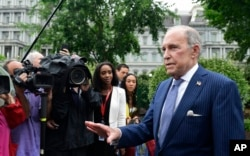 FILE - White House National Economic Council Director Larry Kudlow speaks with reporters at the White House in Washington, June 27, 2018.